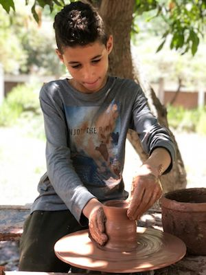 Learning about ancient Amarna: children's pottery class, Egypt