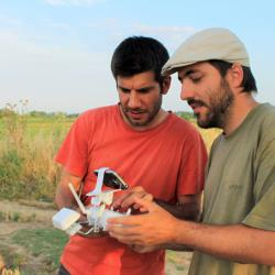 Hector Orengo and Arnau Garcia use a drone in archaeological survey